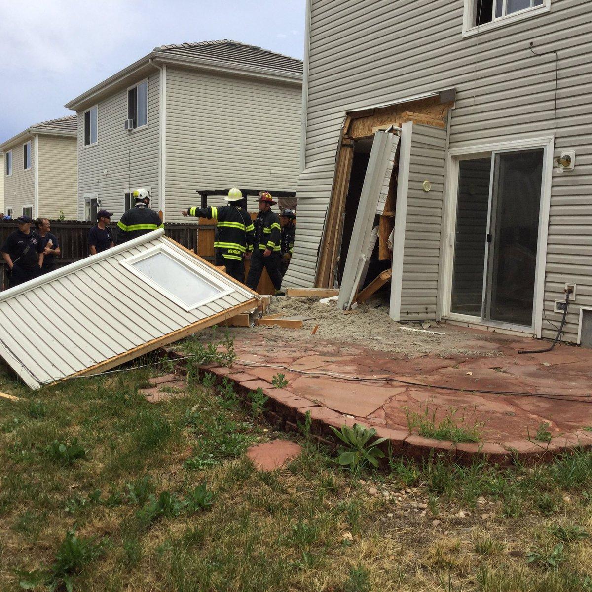 Car Crashes Through Denver House